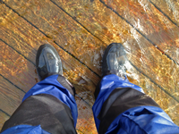 image of water standing over the deck of boat dock