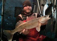 image of Chuck Hasse with big Walleye from Leech Lake