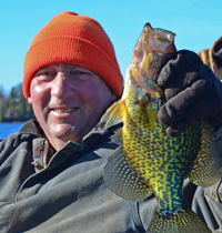 image of Keith Poliachik with giant Crappie