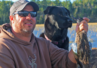 image of Jeremy Taschuk with Black Lab and Greenwing Teal