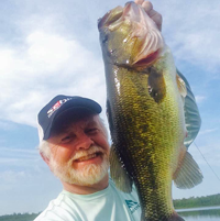 image of Greg Clusiau with huge Largemouth Bass