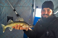 image of ice fisherman with walleye on Red Lake