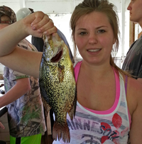 image of woman holding nice Crappie