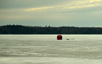 image of an ice fishing shelter on the ice