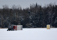 image of fishing shelters and ATV on ice