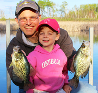 image of Jason Halfen and young angler with slab crappies