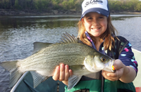image of Mae Edlund Holding Giant White Bass