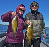 image of Bob and Bonnie Baird with a pair of Smallmouth Bass