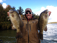 image of Chris Noffsinger with 2 giant Smallmouth Bass