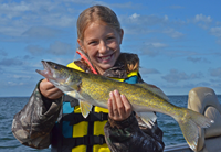 image of Ella Seger with Winnibigoshish Walleye