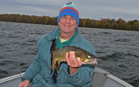 image of Tim Higgins with nice Walleye from Winnibigoshish