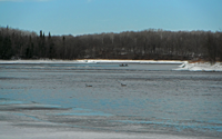 image of small boat on the rainy river