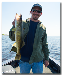 image of Adam Huelse with Red Lake Walleye
