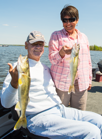 image of bob carlson and susan bolos with nice walleyes