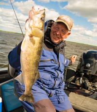 image of fishing guide holding big walleye