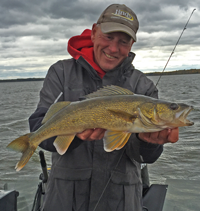 image of walleye guide with big walleye