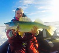 image of Mary Walsh with lake winnipeg walleye