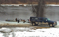 image of small boat at rainy river access