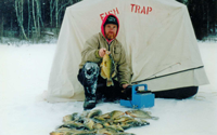 image of a stack of crappies with greg clusiau in background