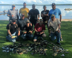 image of fishing group with large catch of Panfish