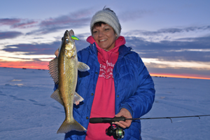 image of hippie chick with nice walleye