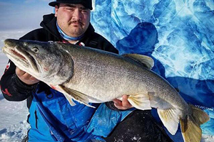 image of Andy Walsh with huge Lake Trout