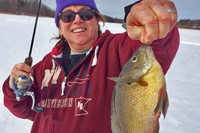 image of ice fisherman with big bluegill