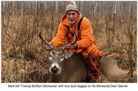 image of mark hill with buck deer