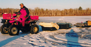 image of terry wickstrom pulling ice fishing sleds