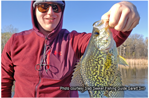image of angler with big crappie
