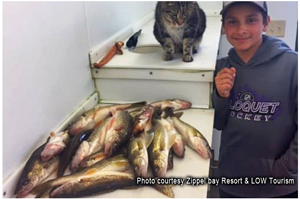 image of kid with lots of walleyes