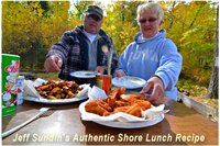 image of couple eating shore lunch