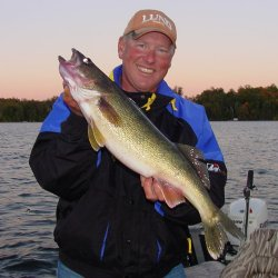 Pro Guide Jeff Sundin with another nice Walleye caught on a creek chebb.